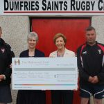 Helen Turner, Assistant Director of the Holywood Trust handing over a cheque for £24000 to President Issy Rainey as a contribution to the U20's Youth Academy Fund